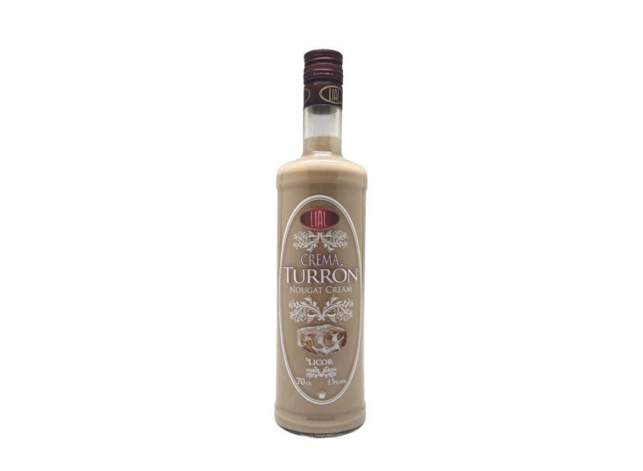 Botella de 70cl de licor de crema de turrón. Producto fabricado en Granada, España. En stock listo para enviar.
